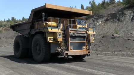 guba : Heavy dump trucks maneuver in quarry
