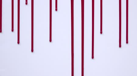 bıçak : Vertically blood flowing on a white background Stok Video