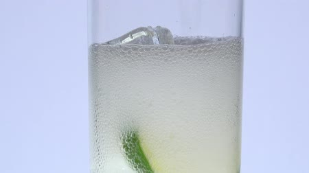 curacao : indian tonic pouring over ice and lemon Stock Footage