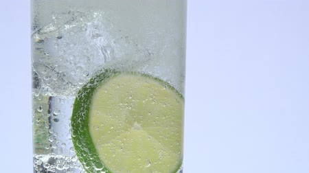 ginástico : glass, ice, lemon and tonic indian Stock Footage