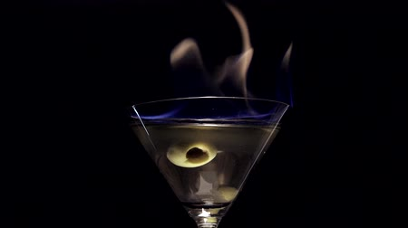 martinis : Fire blowing out of martini glass