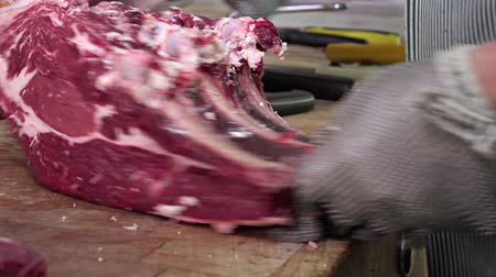 prepaid : the beef ribs are separated with a saw And Then degreased Stock Footage