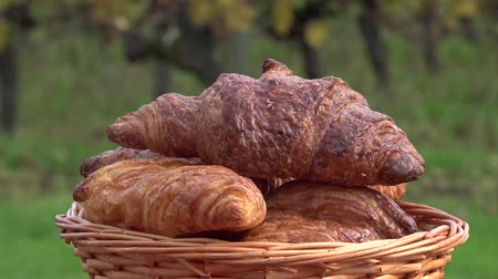 yaldız : French croissants in a rotating basket Stok Video