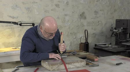 marking the contours of leather with a hot iron
