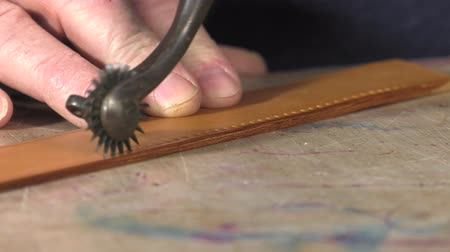 Perforation of the leather with a toothed wheel