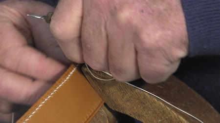 Traditional sewing leather to the point of saddle Stock Footage