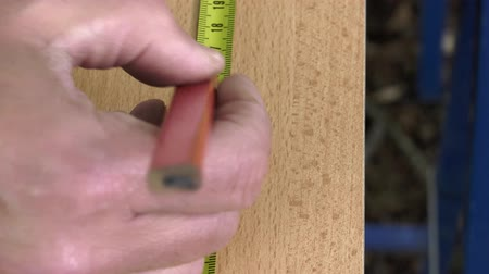 miter saw : Drawing measure the point with a measuring tape and pencil Stock Footage