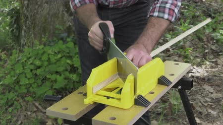 miter saw : Cutting mitered cuts using saw and miter box