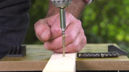 miter saw : laying a wood screw with an electric screwdriver