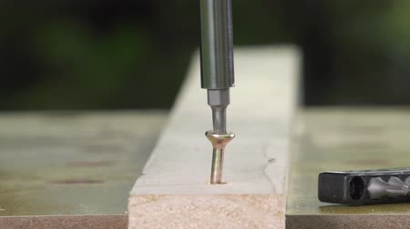 miter saw : unscrewing a wood screw with an electric screwdriver Stock Footage
