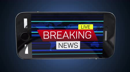 breaking news : Smartphone with breaking news live banner on worldmap Stock Footage
