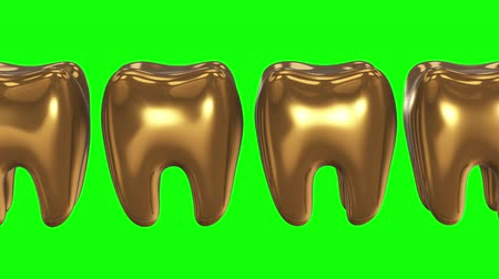 зубная боль : White tooth in a row of the gold teeth. 3D render. Dental, out of crowd, business concept. Video available in FullHD and HD render footage Стоковые видеозаписи