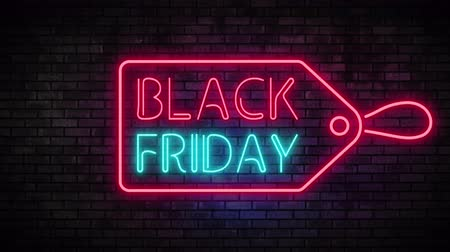 reclame : Black Friday en Sale Tag Neon Light op Brick Wall. Verkoopbanner in nachtclubbalk Knipperende neonbordstijl. Bewegingsanimatie. Video beschikbaar in 4K FullHD en HD renderbeelden