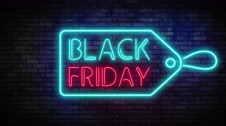Black Friday and Sale Tag Neon Light on Brick Wall. Sale Banner in Night Club Bar Blinking Neon Sign Style. Motion Animation. Video available in 4K FullHD and HD render footage Stock mozgókép