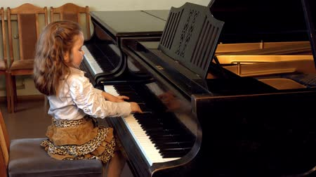lesson : Cute little girl plaing grand piano 4k Dance of the Aborigines by Yoshinao Nakada Stock Footage
