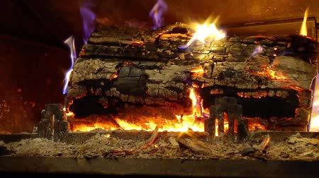 open hearth : Flaming wood in fireplace closeup view, house and comfort. Slow motion.