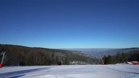 vosges : Beautiful ski slope on mountain resort in Alsace, Vosges. Timelapse view.