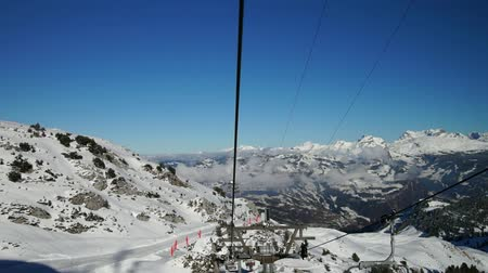 faház : View from the chair lift to the high point on ski resort, sunny day, Switzerland