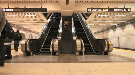 rapid transit : Bart escalator underground platform in San Francisco