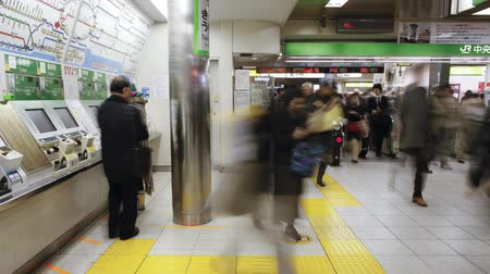 ticket machine : Commuters buying subway tickets from ticket machines at Shinjuku Station Stock Footage