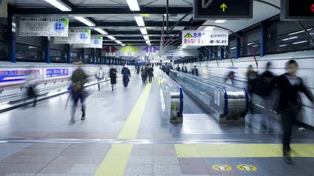 tokyo station : Commuters on a moving walkway in Shibuya station at rush hour Shibuya