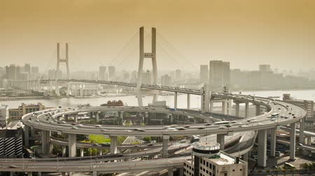 nanpu : high angle wide shot traffic on nanpu bridge spiral shanghai china Stock Footage