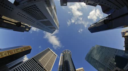 lapse : low angle view of banks and commercial buildings in singapores cbd central