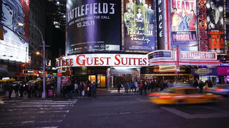 Бродвей : Neon lights of 42nd street Times Square Manhattan New York city New York Стоковые видеозаписи