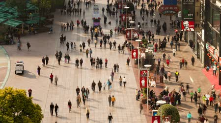 nanjing road : pedestrians walking past stores on nanjing road shanghai china Stock Footage