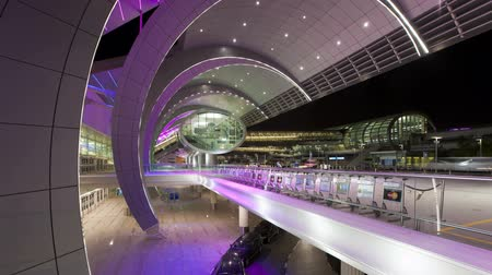 caso : people arriving and departing from dubai international airport with a futur