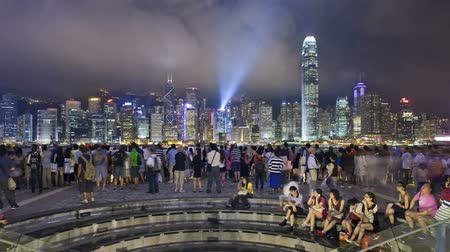 water show : people watching the world famous sound and light show hong kong city skyline