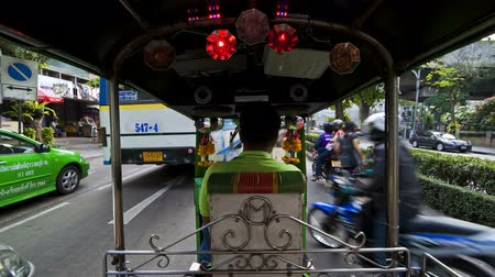 Time lapse of a speeding rickshaw on the busy roads of Bangkok Thailand asia Стоковые видеозаписи