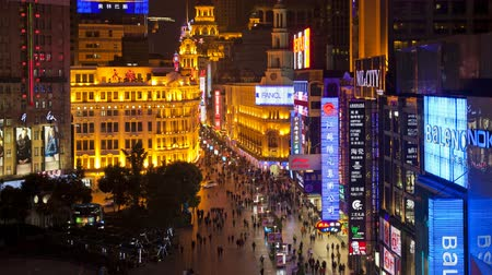nanjing road : Time lapse wide shot of pedestrians walking past stores on Nanjing road at