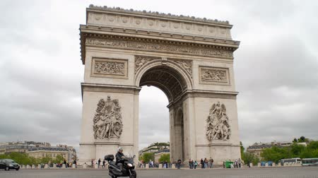triumphal arch : traffic quickly passes around arc de triomphe
