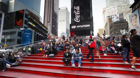 Wide angle view of people enjoying the neon lights of 42nd street Times Square