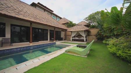 holiday villa : Tropical balinese holiday home with swimming pool and baldachin, Bali, Indonesia. Prores codec.