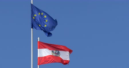 hofburg : Austrian flag together with EU flag on the top of Hofburg Congress center building, Vienna. Stock Footage