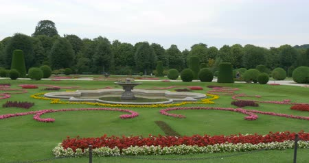 schonbrunn : The Palm House and beautiful gardens nearby in Schonbrunn Palace, Vienna, Austria. The Palm House consists of three pailions for different climatic zones Stock Footage