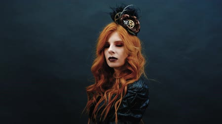 zegar : Steampunk gothic girl poses for the camera