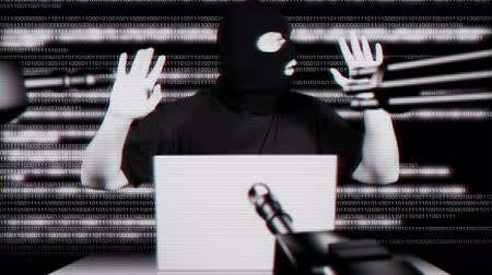 espião : Hacker Working Table Arrested Matrix Stock Footage