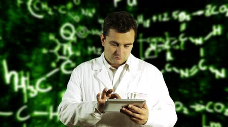 science background : Scientist using Tablet PC with Scientific Chemistry Background Stock Footage