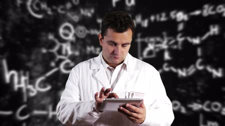 tudományos : Scientist using Tablet PC with Scientific Chemistry Background Stock mozgókép