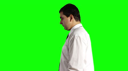 krawat : Young Businessman Looking Down Greenscreen Wideo