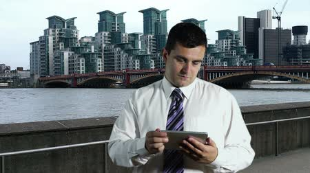 Young Businessman Tablet PC at Thames River London