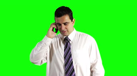 krawat : Young Businessman Talking on Cell Phone Greenscreen