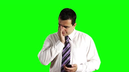 krawat : Young Businessman Touchscreen Phone Getting Bad News Greenscreen Wideo