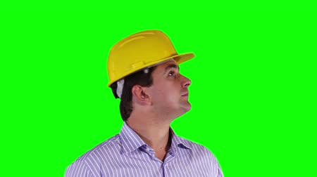 вокруг : Young Engineer Looking Around and Up Greenscreen