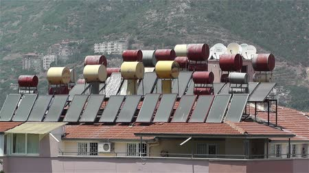 napfény : Sun Collectors and Water Tanks on Rooftops