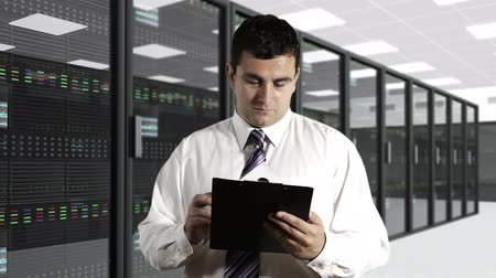 serwerownia : Young Man Checking Documents CPU Server Unit Room