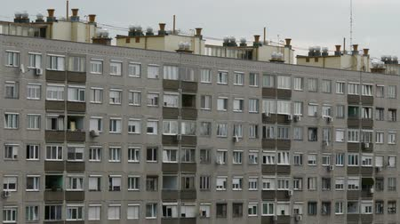 sovyet : 4K Concrete Block of Flats - Typical socialist model building construction type between 1960-1980s in the European Eastern Block and the Soviet Union. Stok Video